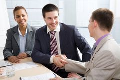 Businesspeople shaking hands. In skyscraper office after meeting royalty free stock photography