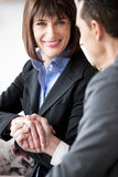 Businesspeople Shaking Hands. Businessman and Businesswoman shaking hands Royalty Free Stock Image