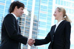 Businesspeople shaking hands. Businesswoman and man shaking hands Stock Images