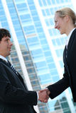 Businesspeople shaking hands. Businesswoman and man shaking hands Royalty Free Stock Photo
