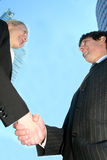 Businesspeople shaking hands. Businesswoman and man shaking hands Royalty Free Stock Photos