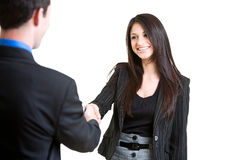 Businesspeople Shaking Hands. Beautiful businesswoman shaking hands with other executive over white background royalty free stock images