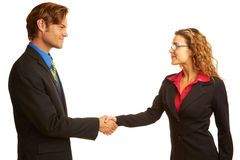 Businesspeople Shaking Hands. Beautiful businesswoman shaking hands with other executive over white background. Horizontal shot royalty free stock image