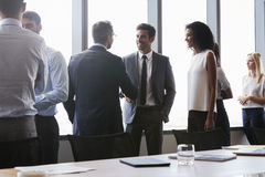 Businesspeople Shaking Hands Before Meeting In Boardroom Royalty Free Stock Images