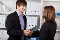 Businesspeople Shaking Hands In Office Royalty Free Stock Photography