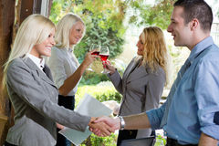 Businesspeople shaking hands  in restaurant,focus on the last tw Stock Photos