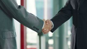 Businesspeople shaking hands stock video