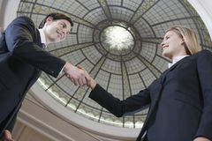 Businesspeople Shaking Hands Under Dome Royalty Free Stock Images