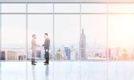 Businesspeople shaking hnads multiexposure Stock Photo