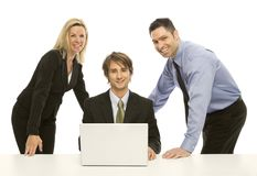 Businesspeople share a laptop. Three businesspeople share a laptop Royalty Free Stock Images
