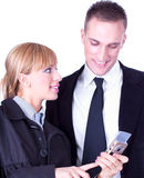Businesspeople sharing info on mobile phones Stock Photo