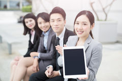 Businesspeople show tablet to you royalty free stock photos