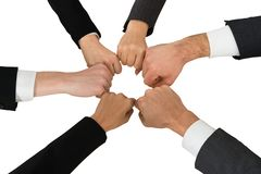 Businesspeople showing fist. Close-up Of Businesspeople Showing Fist In Circle Over White Background Stock Photo