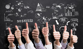 Businesspeople showing many thumbs up to good plan Royalty Free Stock Images