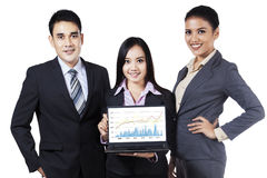 Businesspeople showing profit chart Stock Photos