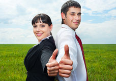 Businesspeople showing thumbs up Stock Images