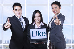 Businesspeople showing thumbs up Royalty Free Stock Images
