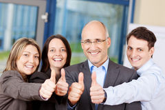 Businesspeople Showing Thumbs Up Sign Royalty Free Stock Photography