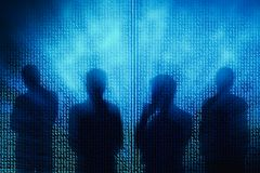 Businesspeople silhouettes binary code background. Abstract businesspeople silhouettes on glowing binary code background. Innovation, computing and robotics Royalty Free Stock Photography