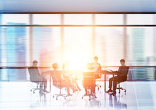 Businesspeople silhouettes in conference room Royalty Free Stock Image