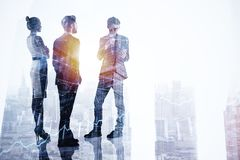 Employment, teamwork and finance concept. Businesspeople silhouettes standing on abstract city background with forex chart and copy space. Employment, teamwork stock images