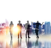 Businesspeople silhouettes with sunlight Royalty Free Stock Photography