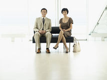 Businesspeople Sitting At Airport Lobby royalty free stock image