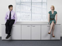 Businesspeople Sitting On Office Cabinets Stock Image