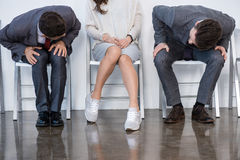 Businesspeople sitting in queue and waiting for interview in office Stock Photos