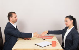 Businesspeople sitting at table Stock Image