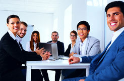 Businesspeople sitting at the table Stock Photos