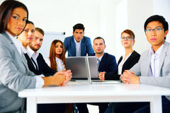 Businesspeople sitting at the table Stock Photography