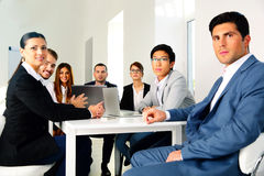 Businesspeople sitting at the table Stock Images