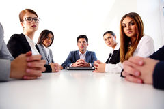 Businesspeople sitting at the table Royalty Free Stock Photo