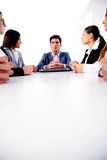 Businesspeople sitting at the table Royalty Free Stock Images