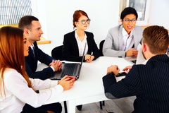 Businesspeople sitting at the table Stock Photo