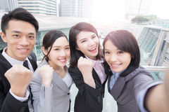 Businesspeople smile happily in hongkong. Businesspeople are smile happily and selfie in hongkong, asian royalty free stock images