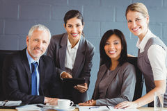 Businesspeople smiling in conference room Royalty Free Stock Photos