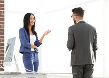 A couple of business partners working together in office. Businesspeople smiling coworking  and taking a business conversation in an office interior Royalty Free Stock Images