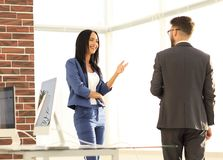 A couple of business partners working together in office. Businesspeople smiling coworking  and taking a business conversation in an office interior Stock Images