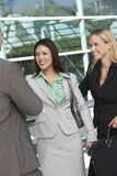Businesspeople Smiling Outside Office Stock Photography