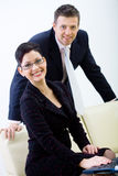 Businesspeople with sofa Royalty Free Stock Photo