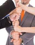 Businesspeople Stacking Fist Stock Photo