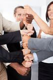 Businesspeople stacking fist over each other Royalty Free Stock Photo