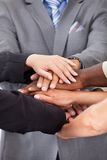 Businesspeople stacking hands Stock Photography