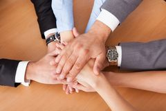 Businesspeople stacking hands Royalty Free Stock Image