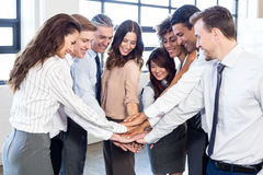Businesspeople stacking hands in office Royalty Free Stock Image