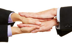 Businesspeople stacking their hands Stock Photos
