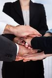 Businesspeople stacking their hands Royalty Free Stock Photos