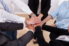 Businesspeople stacking their hands Royalty Free Stock Image